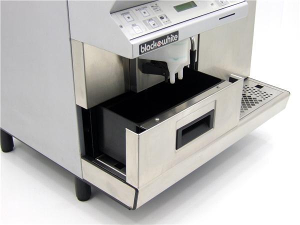 Black and White CT Coffee Machine Nozzle Closeup